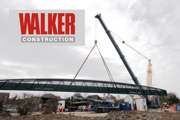 A bridge being lifted into place by Walker Construction